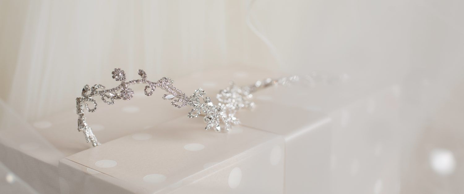 A photo of a silver and crystal wedding tiara